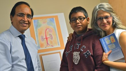 Nephrologist Dr. Mohammid Ilyas enjoys the social event with his patient Alejo, and Dianne