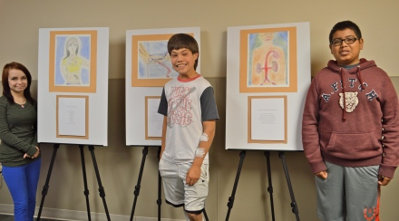 Finished Product: All 3 art participants, standing next to their respective pictures and poems