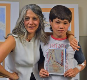 "What a Wisecracker! Diane enjoys self-professed ""character"" Braden (see poem. All teen artists received a personalized catalogue, and this special touch ensured that each received a ""souvenir"" brochure featuring their own art on the cover."